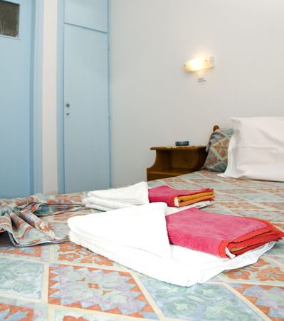 typical basic bedroom in room to rent in greek island studio apartment motel hotel in the cyclades greece Stock Photo - 5050909