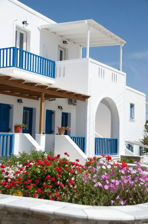whitewashed architecture with arches and blue shutters and rails common to the greek cyclades island with   flowers Stock Photo - 5050883