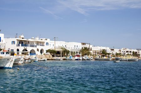 the beautiful  classic port harbor of antiparos island in the cyclades greece with boats and hotels and classic greek island architecture Banco de Imagens