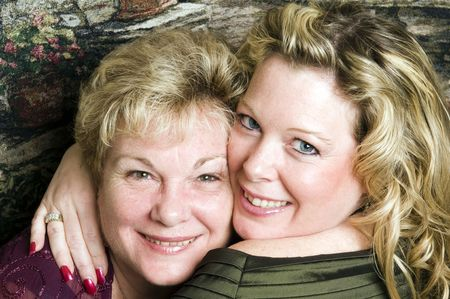 cute mother and glamorous daughter in a family portrait pose head shot Stock Photo - 5068749