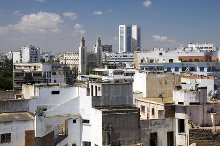 minarets: horizontal city skyline view of casablanca morocco with skyscrapers and a mosque with two minarets in africa Stock Photo