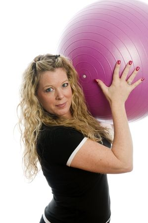 working: pretty plus size middle age woman exercising and working out core training ball Stock Photo