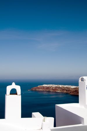 incredible santorini imerovigli mediterranean sea view from whitewashed patio with vocanic thira island view of town of oia on the caldera cliffs  Stock Photo - 5145403