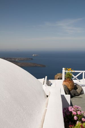 incredible santorini imerovigli mediterranean sea view of cruise ship in harbor from whitewashed patio with large ceramic flower pot Stock Photo - 5145394
