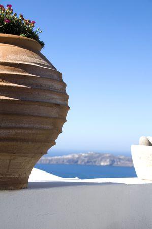 incredible santorini imerovigli mediterranean sea view from whitewashed patio with large ceramic flower pot Stock Photo - 5145397