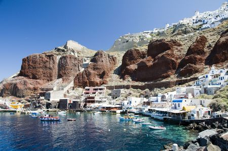 ia: amoudi bay the fishing harbor port built into the caldera on the greek cyclades island of santorini town of oia ia on the mediterranean sea