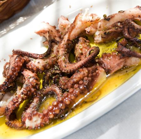 greek island taverna restaurant specialty of marinated grilled octopus  as photographed in antiparos cyclades islands greece photo