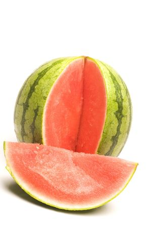 small personal size seedless watermelon with  one section sliced photo