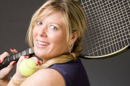 tennis skirt: happy smiling middle age woman tennis player with racquet and ball
