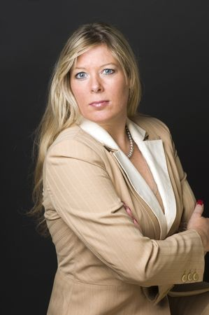 plus size: sexy and attractive blond woman in her forties posing for corporate executive portrait Stock Photo