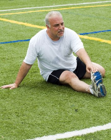 overweight middle age senior man stretching his muscles fitness healthy lifestyle image photo