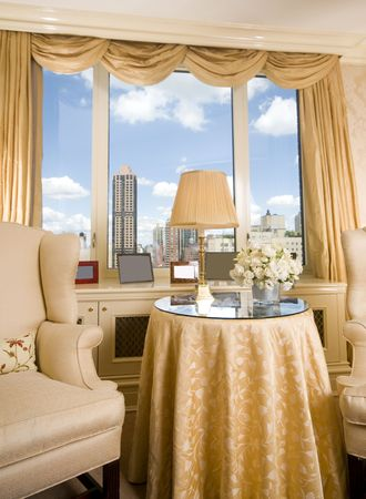 suite: sitting area in luxury penthouse bedroom suite with skyline views of new york city