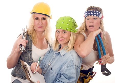 group of sexy contractors or builders or homemaker females with tools and boss writing an estimate contract  photo