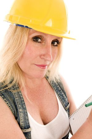 sexy contractor or builder or homemaker female weating hard hat protective helmet and writing an estimate contract Stock Photo