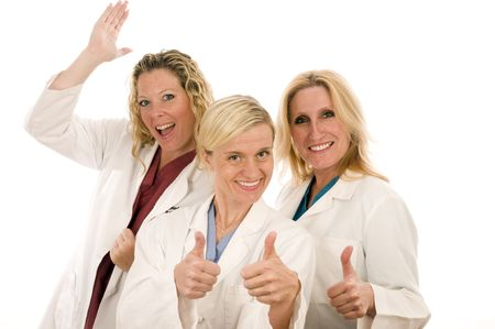 group of three pretty nurses or doctors or medical professionals wearing nurses scrub clothes and lab coats with positive outlook and thumbs up signal photo