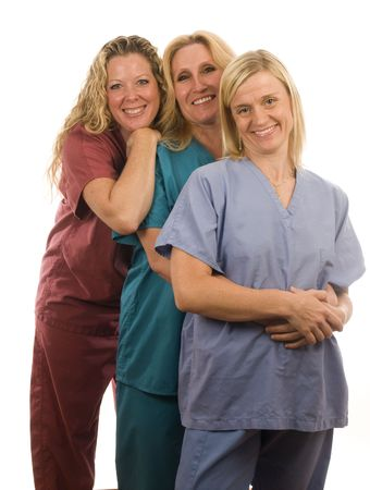 team of three happy and confident female doctors or nurses medical personnel wearing colorful scrubs clothes