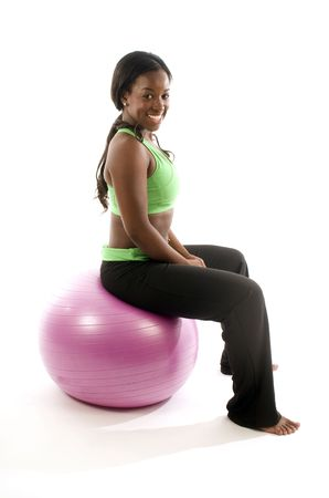 young and pretty hispanic latina black woman wearing exercise tights and working out with fitness core ball photo