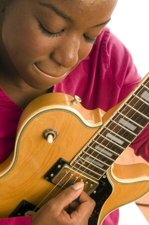 young and pretty hispanic latin black woman musician playing electric guitar photo