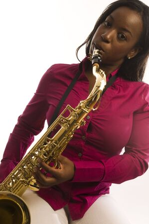 african sax: young and pretty hispanic latin black woman musician playing shiny new tenor saxophone instrument