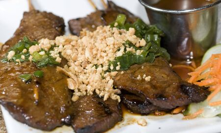 vietnamese food bo nuong sate grilled beef sate skewers with crushed peanut and sate dipping sauce