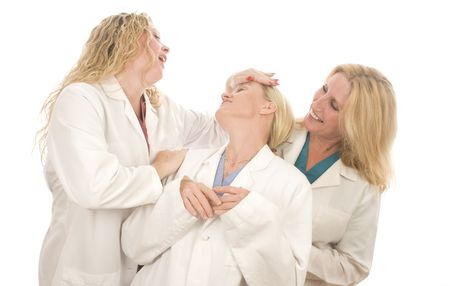 conferring: group of three pretty nurses or doctors or medical professionals wearing nurses scrub clothes and lab coats conferring with positive outlook
