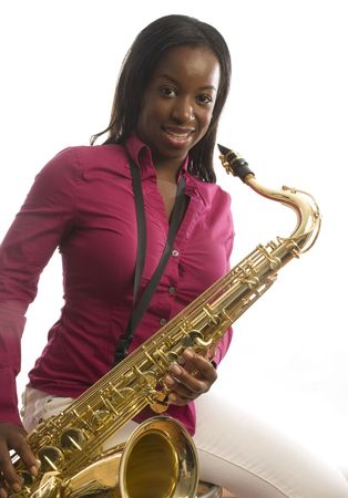 young pretty latin hispanic woman playing a tenor saxophone musical instrument Archivio Fotografico