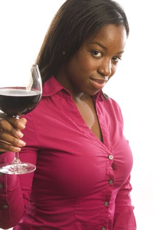 pretty and sexy attractive dark hispanic latin woman toasting with glass of red wine on white background photo