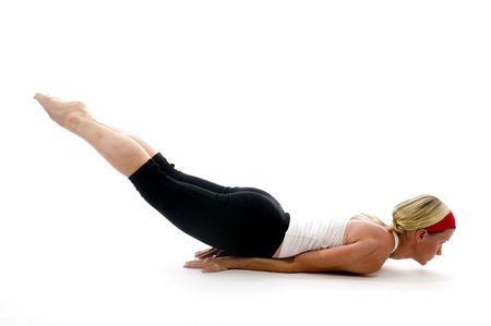 locust: yoga locust pose illustrated by attractive middle age fitness trainer teacher woman exercising and stretching Stock Photo