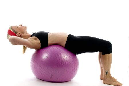 sit: sit ups  strength illustration of sit ups on fitness core training ball with  by attractive middle age fitness trainer teacher woman exercising and stretching