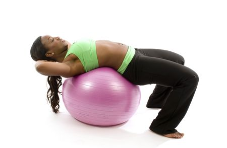 young and pretty hispanic latina black woman trainer wearing exercise tights and working out sit ups with fitness core ball photo