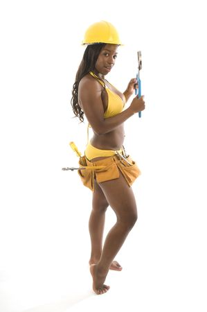 bikini construction: sexy hispanic black woman contractor construction pin up model woman in bikini with tools and hard hat helmet