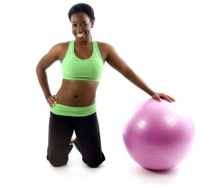 young and pretty hispanic latina black woman trainer wearing exercise tights and working out fitness core ball photo