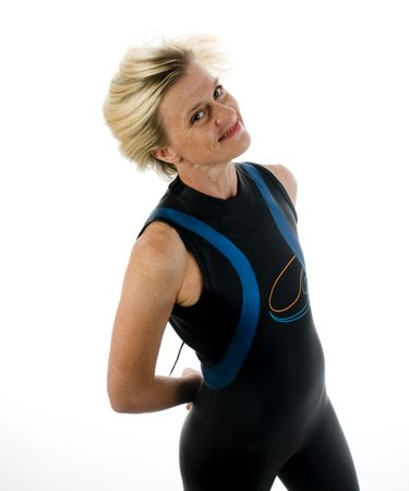 athletic gear: attractive middle age female triathlete in marathon diver scuba wet suit Stock Photo