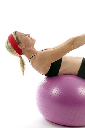 attractive middle age trainer woman doing sit ups on fitness core training ball