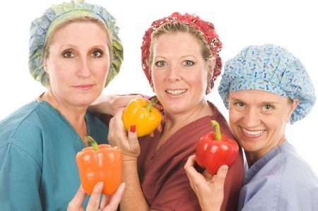 team of female nurses or doctors promoting healthy diet with fruits and vegetables Stock Photo - 5620468