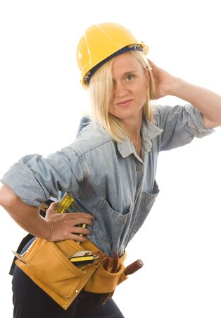 pretty middle age woman contractor or builder with tools tool belt and protective hard hat helmet photo