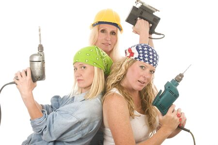group of sexy contractor or builder or homemaker females construction workers with electric power tools photo