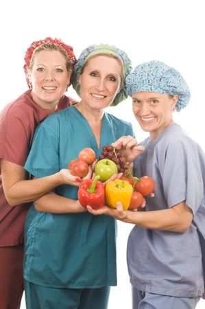 team of female nurses or doctors promoting healthy diet with fruits and vegetables Stock Photo - 5746258