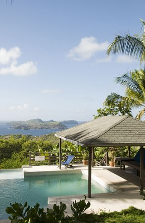 luxury caribbean bequia island villa hotel pool with view of baliceaux, mustique, battowia island st. vincent & the grenadines photo