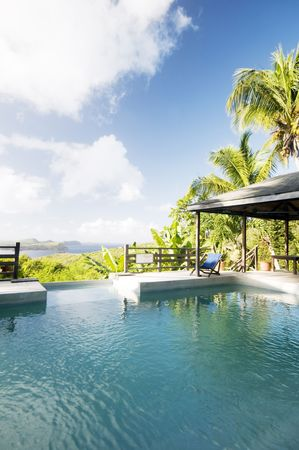 grenadines: luxury caribbean bequia island villa hotel pool with view of mustique battowia baliceaux grenadine island st. vincent Stock Photo