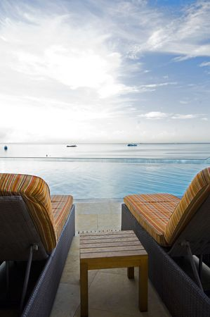 waterfront: luxurious infinity swimming pool over gulf of paria caribbean sea hotel port of spain trinidad and tobago