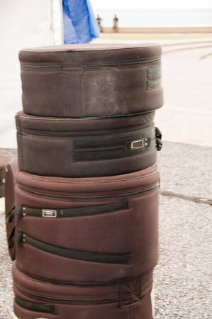 cushioned: custom made carrying transport cases for steel pan drum musical instruments roadside after concert port of spain trinidad Stock Photo