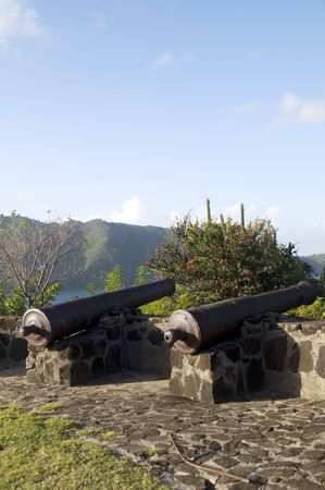 grenadines: old canons at fort hamilton overlooking admiralty bay caribbean sea in the island of bequia st. vincent and the grenadines