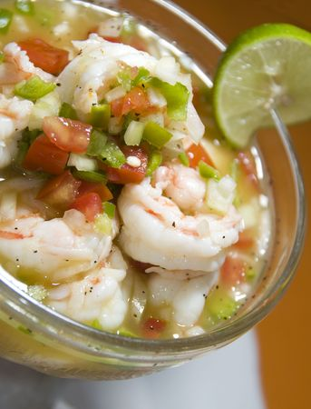 shrimp ceviche seviche latin america style with tomatoe peppers chillis and onion with lime slice as photographed in nicaragua central america Stock Photo