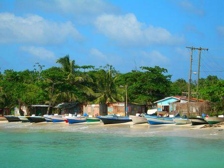 native panga fishing boats on beach with native zinc houses brig bay corn island nicaragua central america