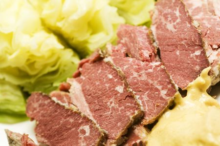 corned beef meat slices and cabbage with dollop of mustard for st. patricks day