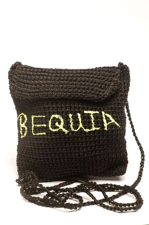 carryall: knitted small change purse bag souvenir of the island of bequia st. vincent and the grenadines Stock Photo