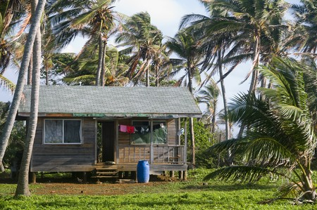 cabana: basic simple beach house cabana in Nicaragua Corn Island jungle with laundry drying in wind