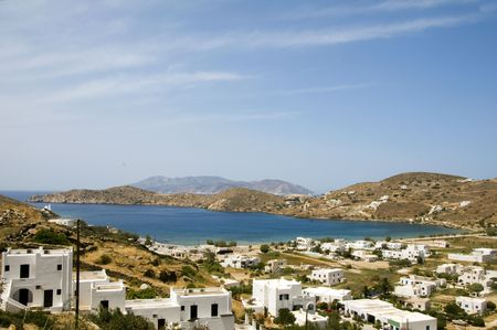 whitewashed: panoramic view of Cyclades Greek island of Ios with Mediterranean Aegean sea and mountains typical whitewashed buildings Greece