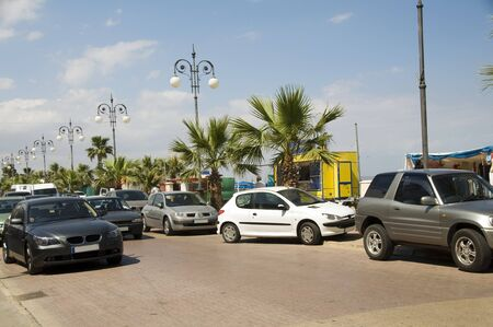 cars along palm tree lined Athens Avenue Larnaca Cyprus for the festival of the kataklysmos after Easter photo